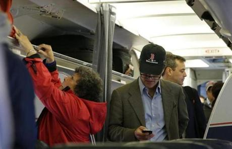 A man wore a Red Sox World Series hat as he boarded a plane in Boston.
